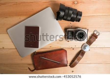 time to plan travel concept,  passport  watch and camera