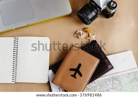 time to plan travel concept, stylish passport with plane, map watch and camera on craft background - stock photo