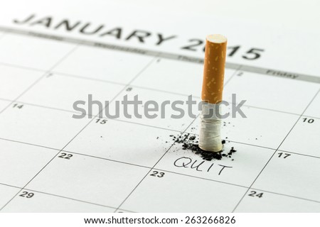 Time to quit smoking concept using cigarette on calendar - stock photo