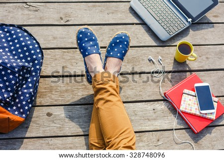 Time to rest. Lifestyle, summer vacation, education and people concept. Young hipster girl have a break while studying outdoor. - stock photo