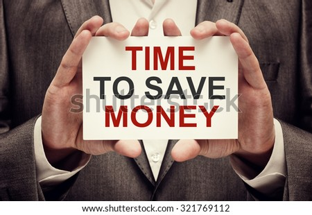 Time to Save Money concept. Man holding a card with a message te - stock photo