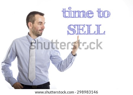Time to sell Young businessman with small beard touching text