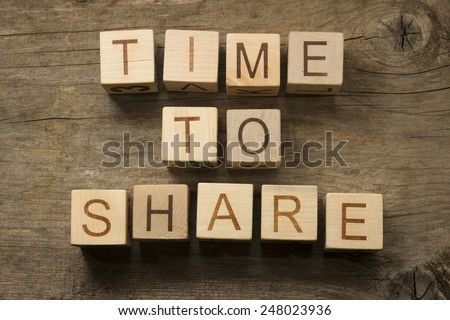 Time to Share text on a wooden background - stock photo
