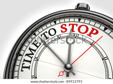 time to stop concept clock closeup on white background with red and black words