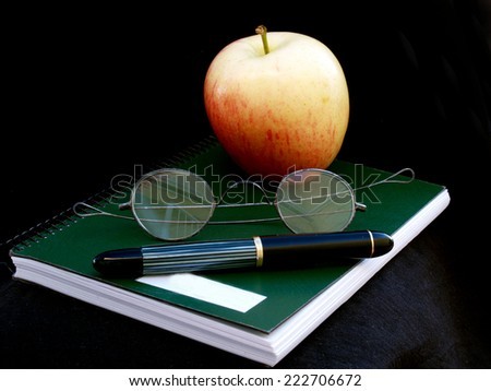 time to study: notebook, glasses, fountain pen and apple         - stock photo