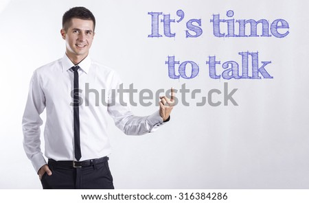 time to talk - Young smiling businessman pointing on text