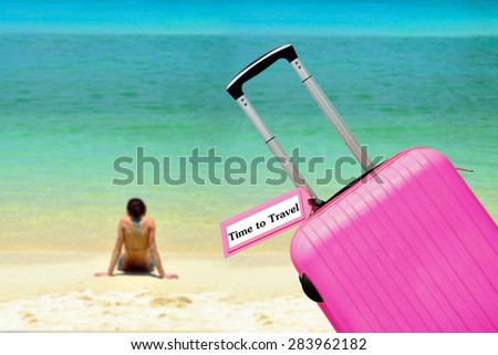 Time to Travel. Suitcase with label at sea. - stock photo