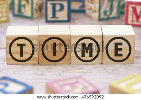 TIME word written on wood cube - stock photo