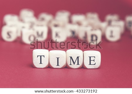 Time word written on wood cube with red background - stock photo