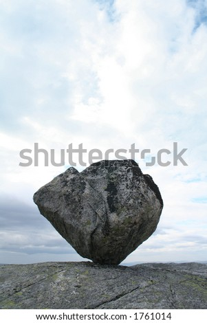 Timeglaset - a 3 tonnes balancing rock in Voss, Norway - stock photo