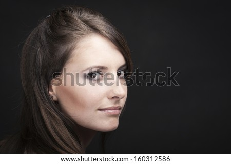 Timeless beauty portrait of a beautiful woman in a black background - stock photo
