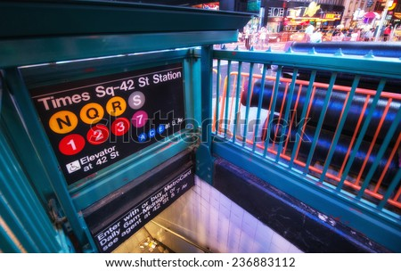 Times Square Entrance subway station at night - New York City. - stock photo