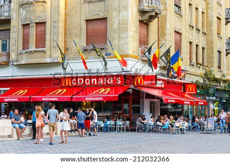 TIMISOARA, ROMANIA - JULY 22, 2014: McDonalds restaurant at Piata Victoriei, Timisoara, Romania. Mc Donalds is the world biggest fast food chain. - stock photo