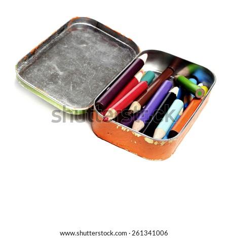 Tin bin of colored pencils representing creative art artistic creation - stock photo
