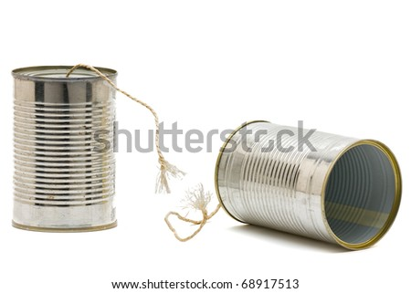 Tin can phone with broken string -  communication issue concept - stock photo