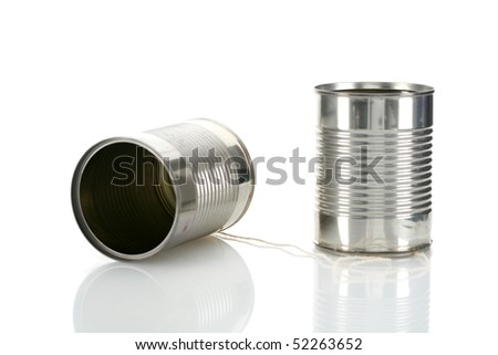 Tin Can telephone on white with reflections - stock photo