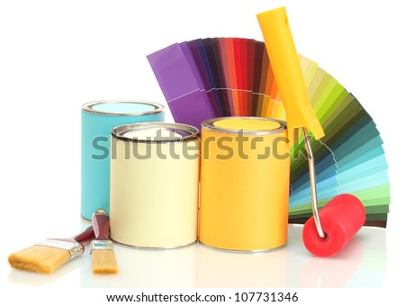 tin cans with paint, roller, brushes and bright palette of colors isolated on white - stock photo