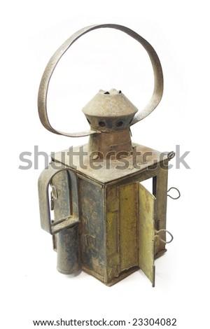 tin lantern, lit - stock photo