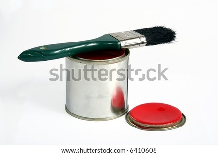 Tin of red paint with a brush on top of it - stock photo