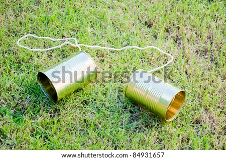 tin phone on grass field - stock photo