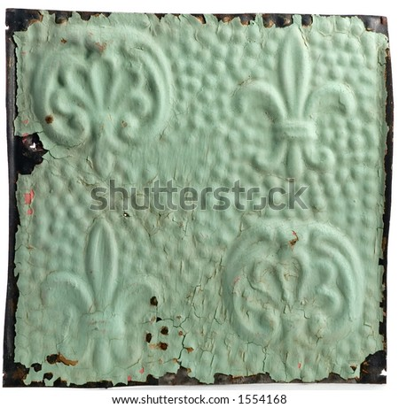 Tin wall pannel with fleur-de-lis design. - stock photo