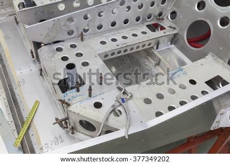 tin workshop, making airplane parts - stock photo