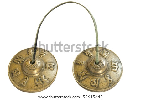 Tingsha or Karatal performed by the same Tibetan masters who make singing bowls. They are done according to the old formula transmitted over many centuries from master to apprentice. - stock photo