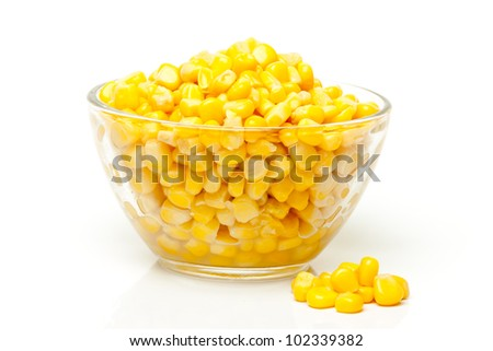 tinned corn in a transparent bowl on a white background - stock photo