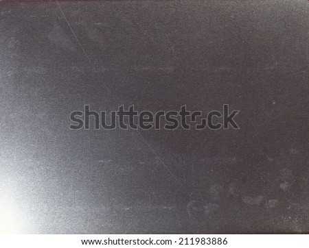 Tinplate cookie containing box inner side show the shiny grain texture detail represent as a noise in the digital photograph file. - stock photo