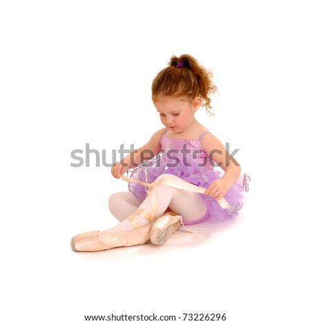 Tiny Ballet Dancer playing dressup in Pointe Shoes - stock photo