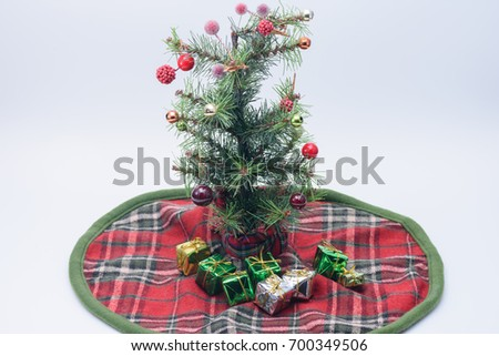 tiny christmas tree with presents on tree skirt - Tiny Christmas Tree