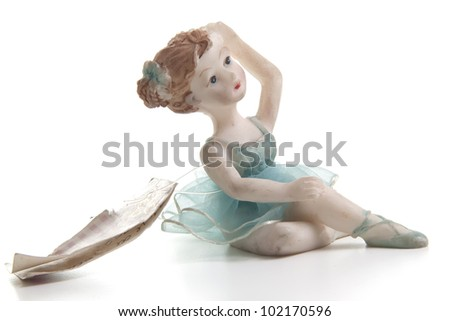 tiny dancer shaped souvenir on withe background - stock photo