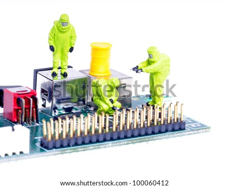 tiny figures of chemical team in hazmat suits examining  integrated circuit - stock photo