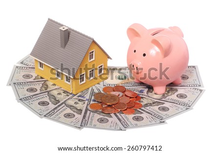 Tiny house, piggy bank and money isolated. Mortgage Concept - stock photo