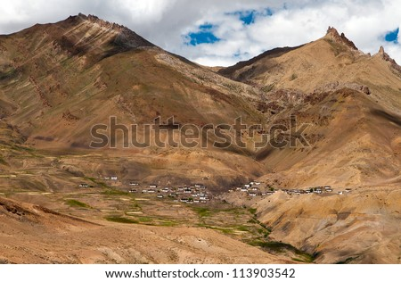 Tiny houses of Chicham village in himalayan mountain valley at Spiti district of Himachal Pradesh. - stock photo