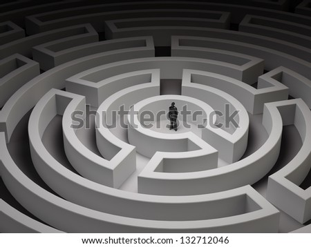 Tiny man in an endless maze - stock photo