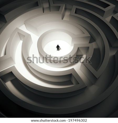Tiny man inside an endless maze - stock photo