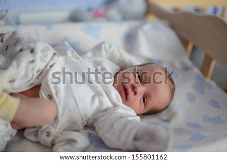tiny newborn with open eyes