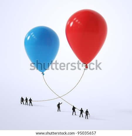 Tiny people holding a balloon - stock photo