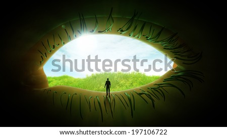 Tiny person standing looking at a meadow through an open eye - imagination concept - stock photo