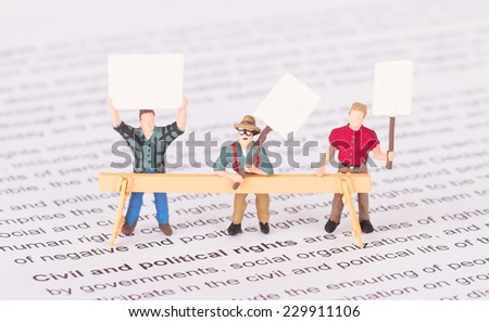 Tiny persons demonstrating for their rights - Civil and political right - stock photo