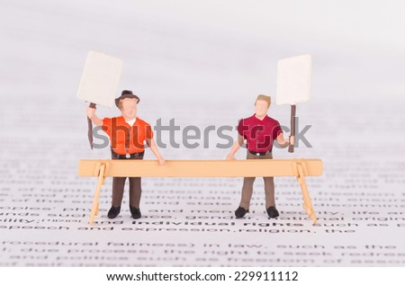 Tiny persons demonstrating for their rights - Individual rights - stock photo