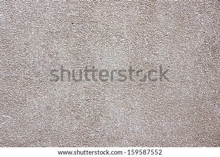 Tiny stone concrete wall texture. - stock photo