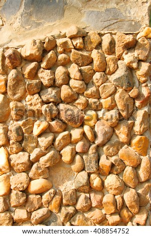 tiny stone decorated on home wall background
