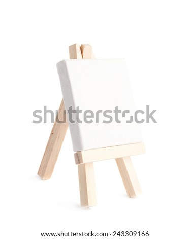 Tiny toy easel with a copyspace canvas, composition isolated over the white background - stock photo