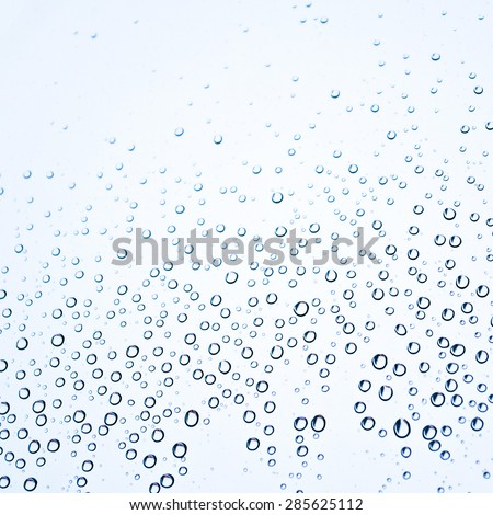 Tiny water droplets on glass - stock photo