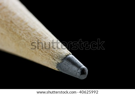 Tip of pencil over black with shallow DOF, focus where the wood meets the graphite