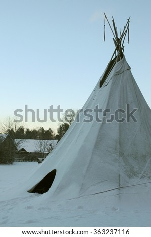 Tipi as used by Native Americans in America now stands in Lithuania woods covered with snow - stock photo