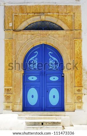Tipical ancient blue Tunisian doorway - stock photo