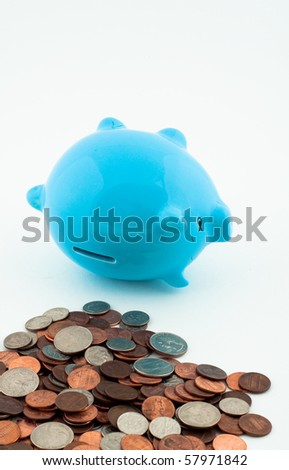 Tipped Over Piggy Bank and Coins - stock photo